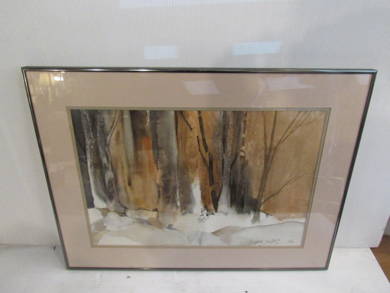 Framed painting by New Jersey artist Patricia Davis-Ganek. A snowy landscape is rendered in watercolors and held in a metal frame with glass cover. Please confirm item location with seller (NY/NJ).