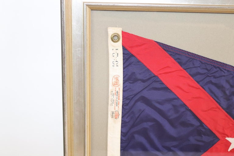 Framed yacht club burgee with blue field, red stripes, and white star. Weight is 10 pounds.