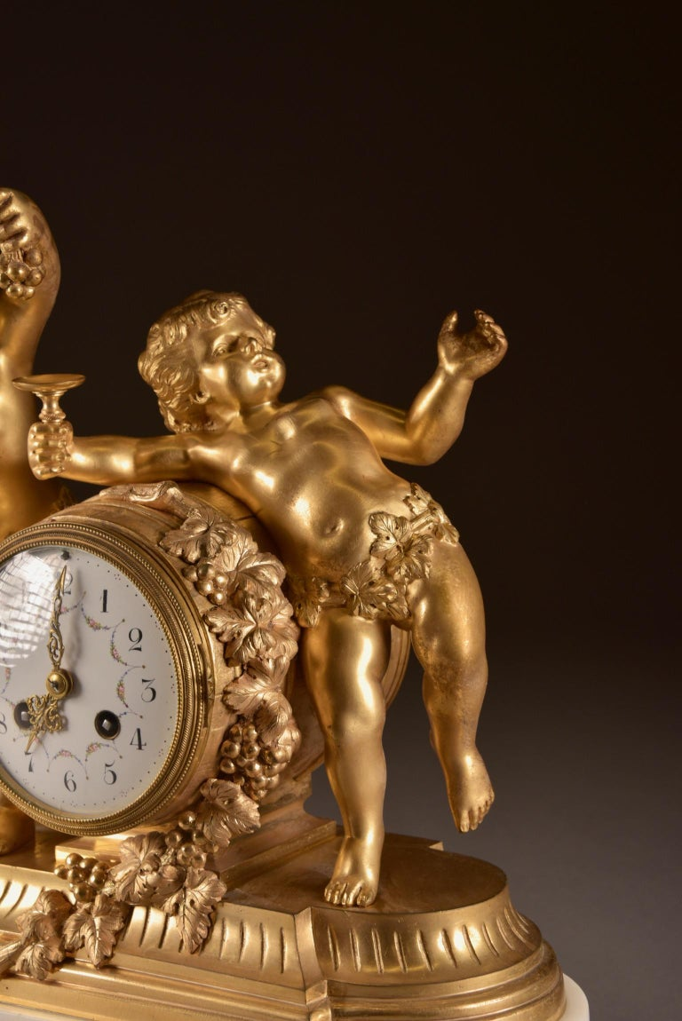 Gilt France, second Empire pendule (1840-1860) large Cupido Clock with 2 candlesticks For Sale