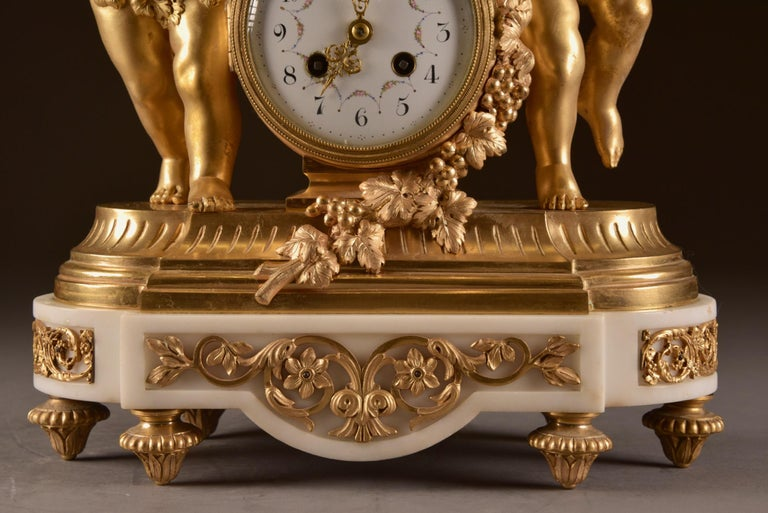 France, second Empire pendule (1840-1860) large Cupido Clock with 2 candlesticks For Sale 1