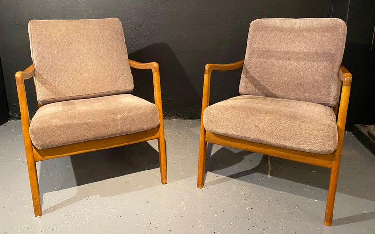 Pair of France & Daverkosen Teak Armchairs from Mid-Century Modern era. If sleek and stylish are what you are seeking look no more. This finely constructed branded pair of lounge chairs (Backrest bears label