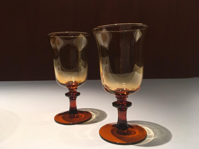 This pair of French blown glass gobelets are elegant to arrange an Holiday table dining. The amber glass has an intense and vivid color. Perfect to refresh a traditional dining set dishes, placing in contrast for color or style.