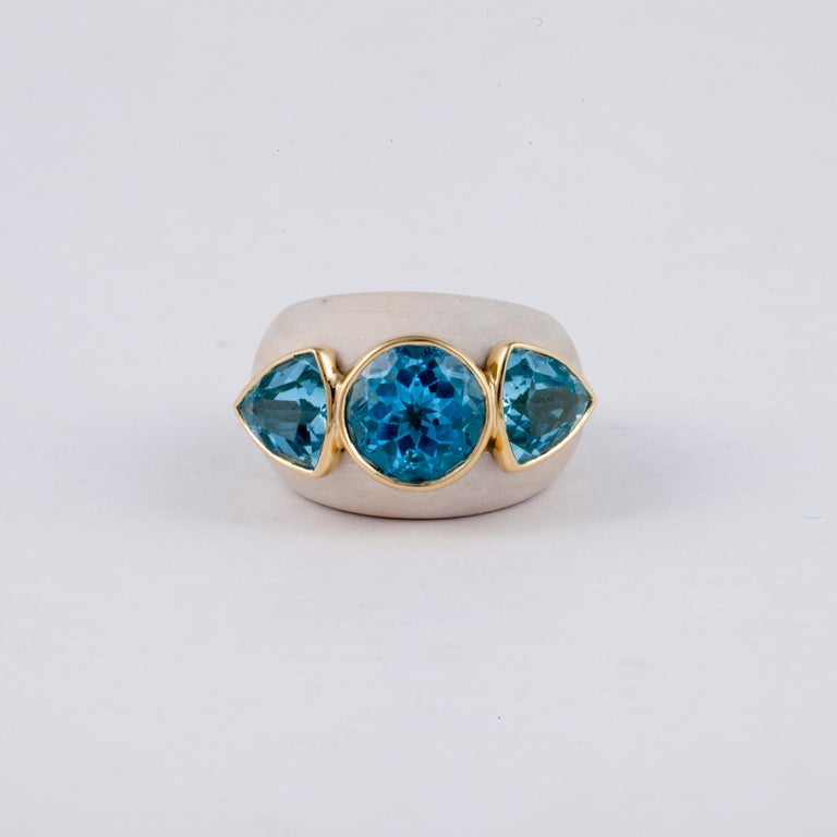 18K yellow gold ring by Francesca Visconti.  The ring is made of wood with a yellow gold liner.  There are three (3) blue topaz stones on top bezel set in yellow gold.  Ring measures 1-1/4