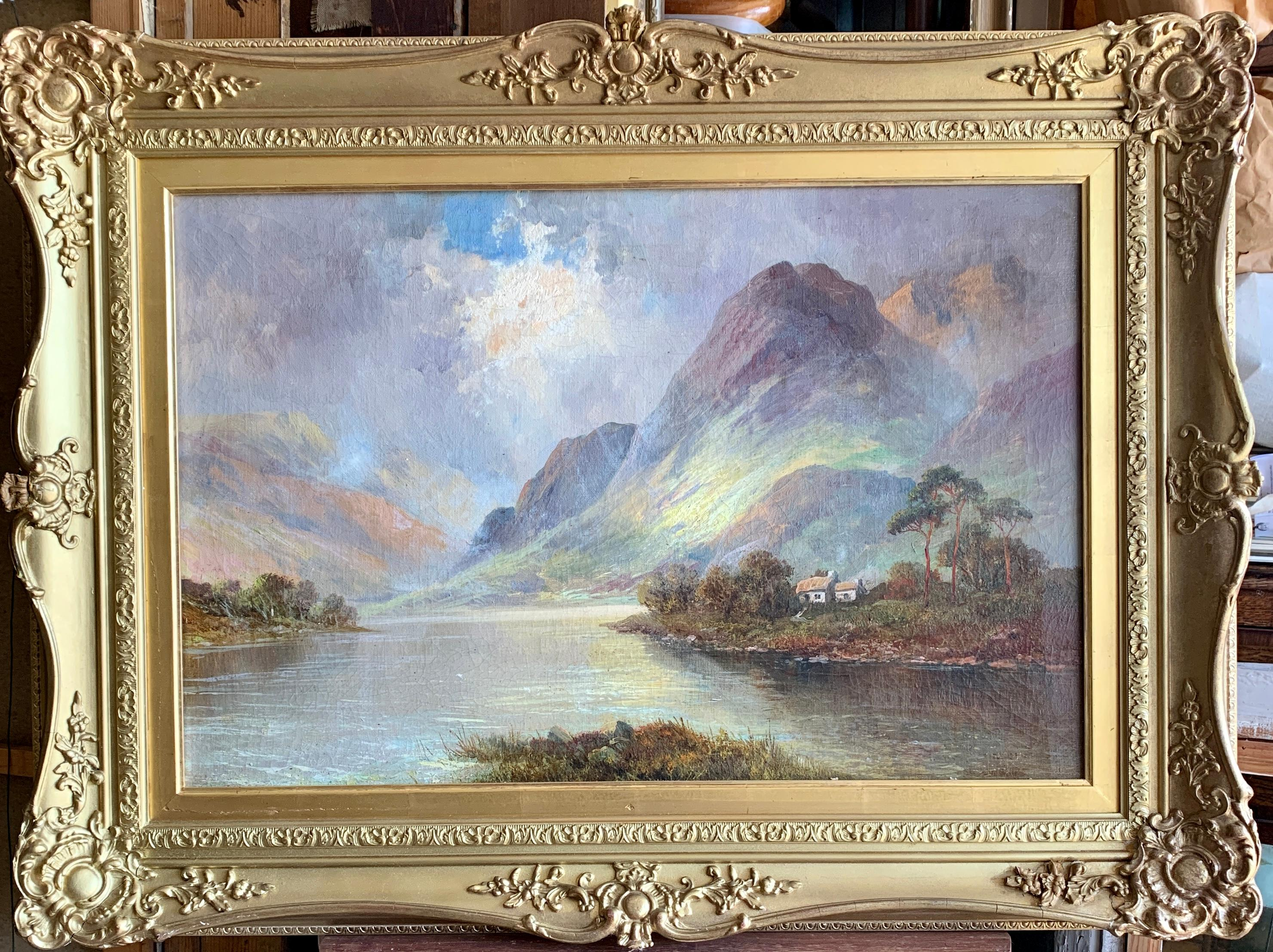 Antique Scottish Highland Loch landscape, with sunlit streaming onto the water