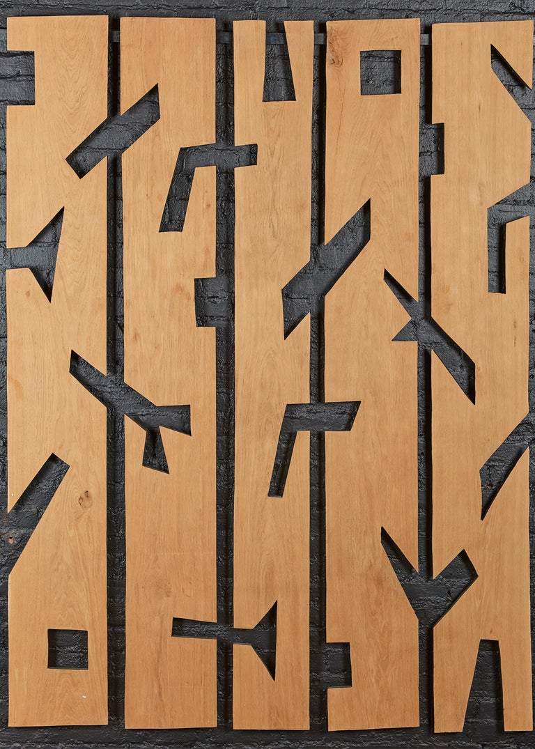 An expressive set of five large-scale wooden panels, emphasizing negative space over ornamentation. As with his totems, the French artist Franck Evennou imbues his natural subjects with a subversively playful quality all his own.  Dimensions are