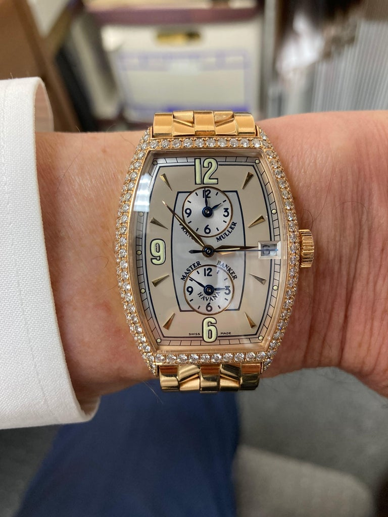 Franck Muller Master Banker 8850 Havana Model with diamond case in 18k pink gold, fits a small wrist size.  This is an automatic 3 time zone wristwatch with date. CASE SIZE: 31.5mm by 44.5mm (1.25
