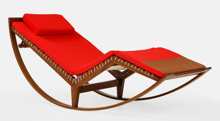 Franco Albini for Poggi rocking chair model PS16 with walnut frame and upholstered red cushion and saddle leather details on canvas seating tied with rope.  This iconic chair was designed in 1956 by Franco Albini and produced by Carlo Poggi, Pavia,