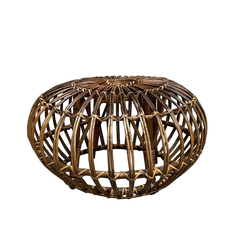 Round handwoven rattan, wicker ottoman, pouf, footstool or side table in the style of Franco Albini. 
