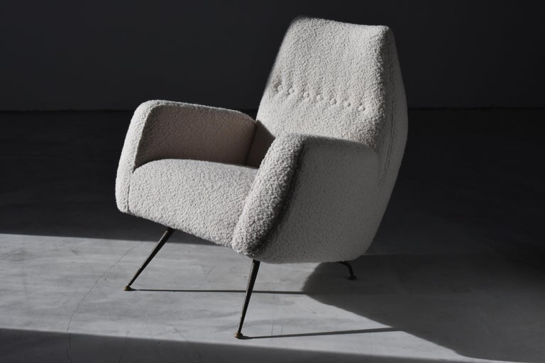 A highly modernist Italian lounge chair. Attributed to Franco Campo & Carlo Graffi.   Most likely produced by Melchiorre Bega (See Phillips Auction Design Day Sale 28 April 2016, lot 195, for a pair of similar model determined to produced by