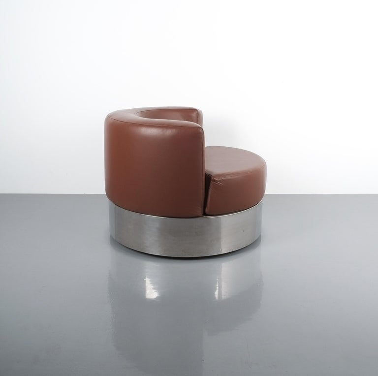 Rare Franco Fraschini brown leather chair for Driade, Italy, 1965. Stylish geometrical leather chair on a shiny chrome with casters to move the chair around. The condition is very good with newly upholstered leather in chocolate brown.
