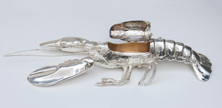 An impressive silver plated life-size lobster by Franco Lagini, Italy, 1970s.  Marked on base Franco Lapini, Made in Italy. Each of Lapinis creations appears to be unique.