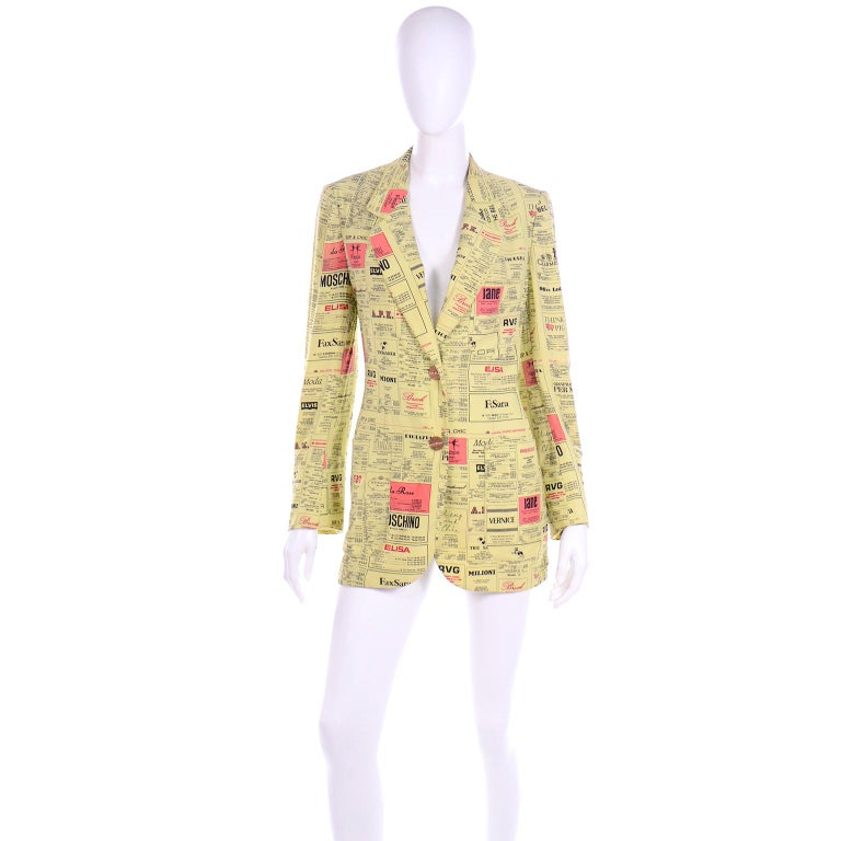 This important vintage 1990's Cheap and Chic by Moschino novelty printed blazer is one of Franco Moschino's iconic designs! The yellow pages print spoofs designer labels by giving them different names.. Chanel is Cocco Che Bel, Hermes is Charmes,