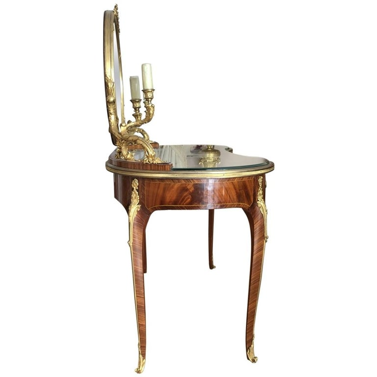 Francois Linke gilt bronze branches and candle arms sit on an inset glass top. Features three legs to store all your cosmetics and beauty needs.