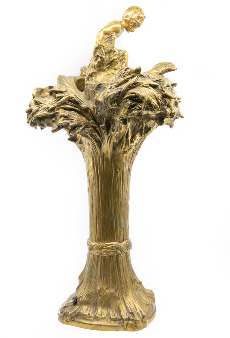 François-Raoul Larche bronze lamp, France, early to mid-20th century, depicting putti frolicking in wheat stalks,