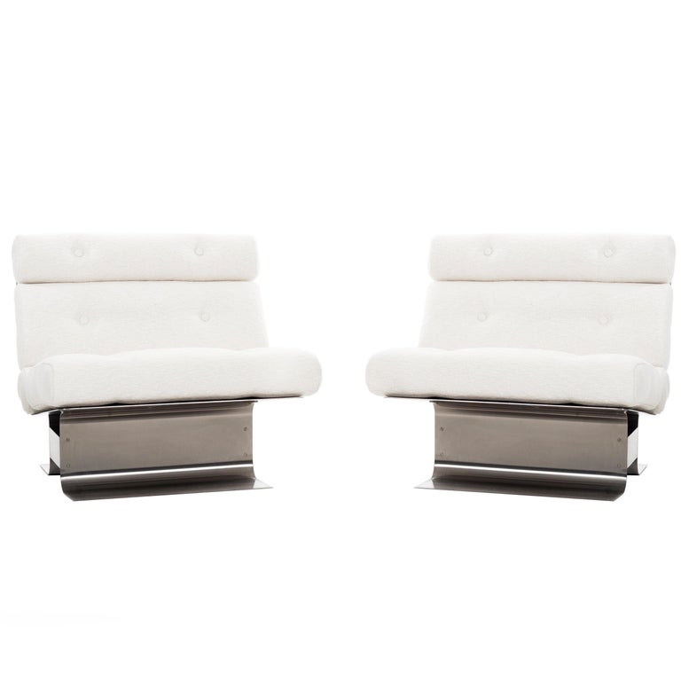 Pair of François Monnet lounge chairs, 1970, offered by Converso