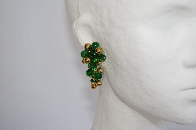 Green and gold glass clip earrings inspired after a bunch of grapes from French design house Francoise Montague.