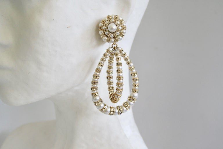 Iconic earring style from famed jewelry design house Francoise Montague. Made with glass pearl vintage beads and Swarovski Crystal rondelles on gold.