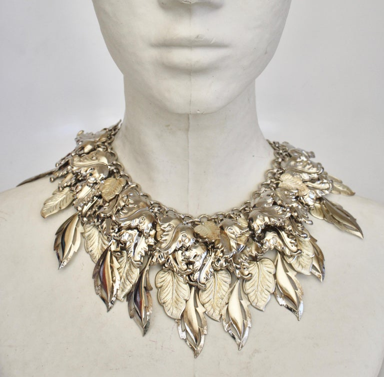 Rhodium charm statement necklace from French design house Francoise Montague.