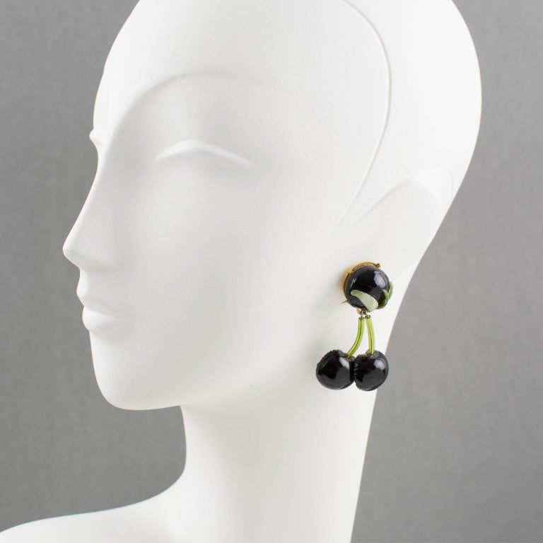 Lovely French jewelry designer Francoise Montague Paris resin clip-on Earrings. Long dangle shape, featuring dimensional cherries with leaf in assorted tones of true licorice black with purple overtone and tender green colors. No visible signature