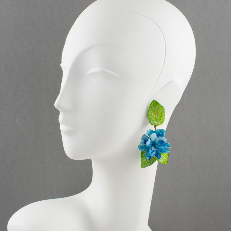 Refined resin clip-on earrings designed by Cilea Paris for French jewelry designer Francoise Montague. Oversized dangle shape featuring dimensional blue hydrangea (hortensia) flowers with green leaves. No visible signature like all the vintage