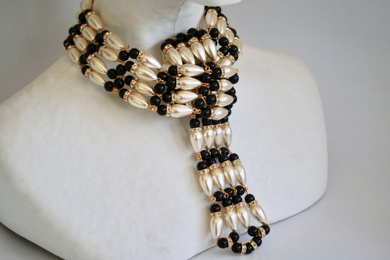 """Handmade glass pearl and glass bead knot front choker necklace from French designer Francoise Montague.   14"""" around the neck with the possibility of 3"""" extension chain. Drop  is 4.5"""" long and 1.75"""" wide"""
