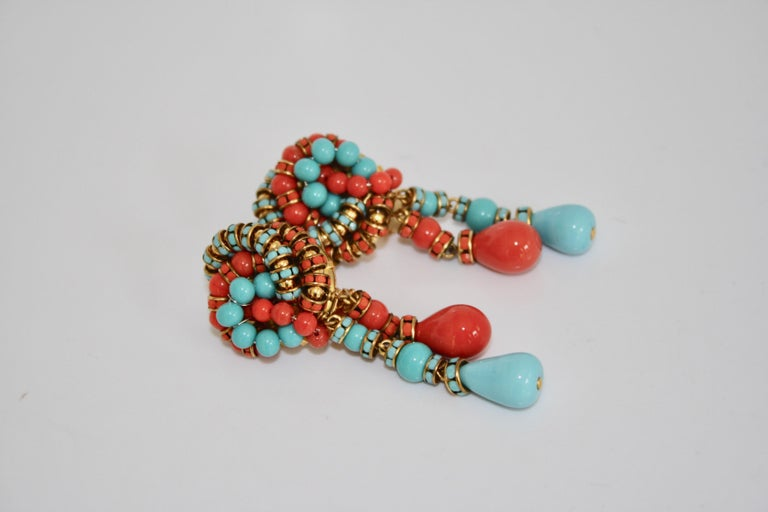 Knot and double drop clip earrings in turquoise and orange glass from Francoise Montague.