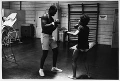 Lola Falana boxing in the gym photographed by Frank Dandridge, 1969.