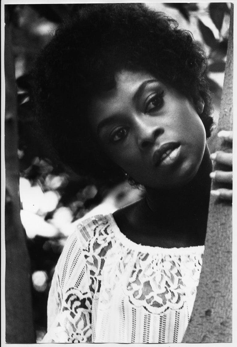 Frank D. Dandridge Black and White Photograph - Lola Falana poses behind a tree photographed by Frank Dandridge, 1969.