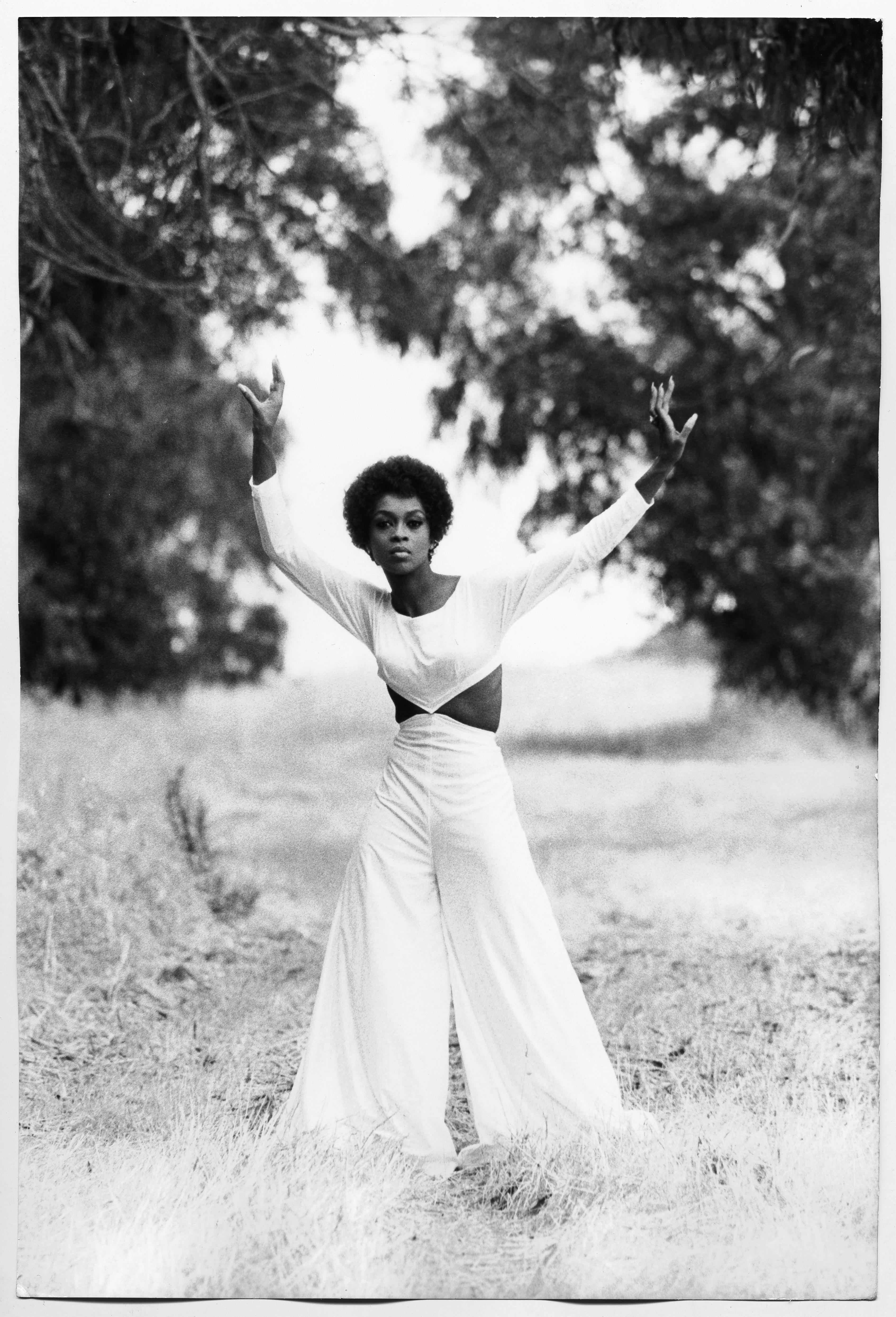 Lola Falana poses in the green photographed by Frank Dandridge, 1969.