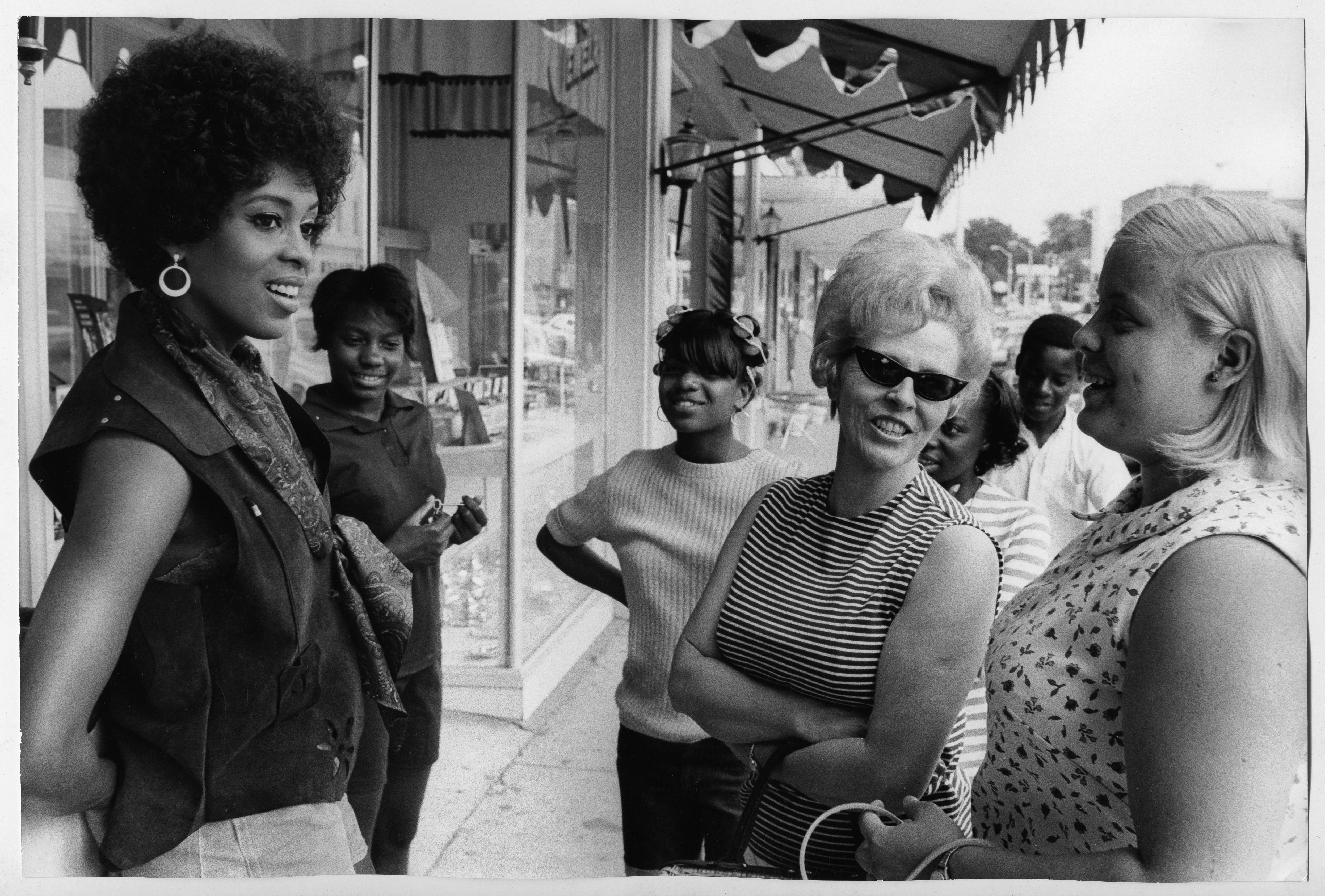 Lola Falana with women on the street photographed by Frank Dandridge, 1969.