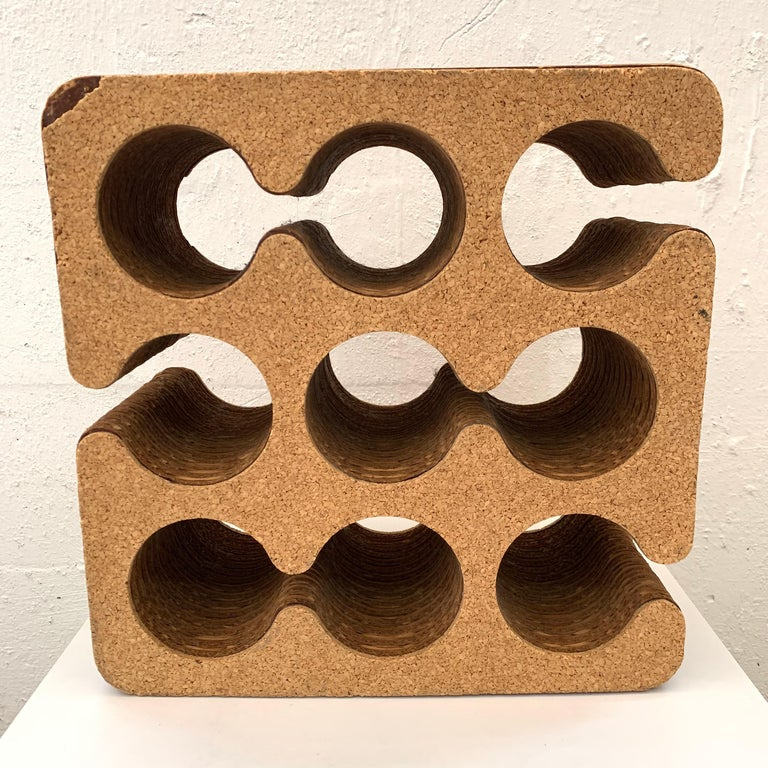 Postmodern sculptural 9 bottle wine rack of holder rendered in corrugated card board with cork exterior designed by Frank Gehry for his Easy Edges line, 1980s.