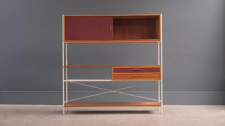 A beautiful and rare model 611 room divider in all original paint with wonderful patina designed in 1955 by Frank Guille for Kandya, UK. Exceptional example of this elegant 'double sided' design.