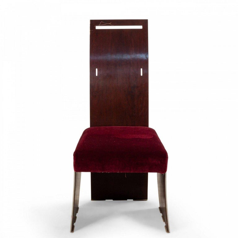 Set of 16 American 1940s style (Frank Lloyd Wright design) mahogany and metal geometric form dining chairs with a high back and flared arms with an upholstered seat. (12 arms 4 sides).