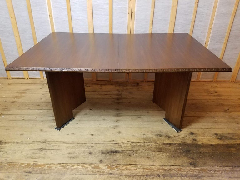 A mahogany dining table designed by Frank Lloyd Wright as part of his Taliesin line of furniture manufactured by Heritage Henredon between 1955-1956.