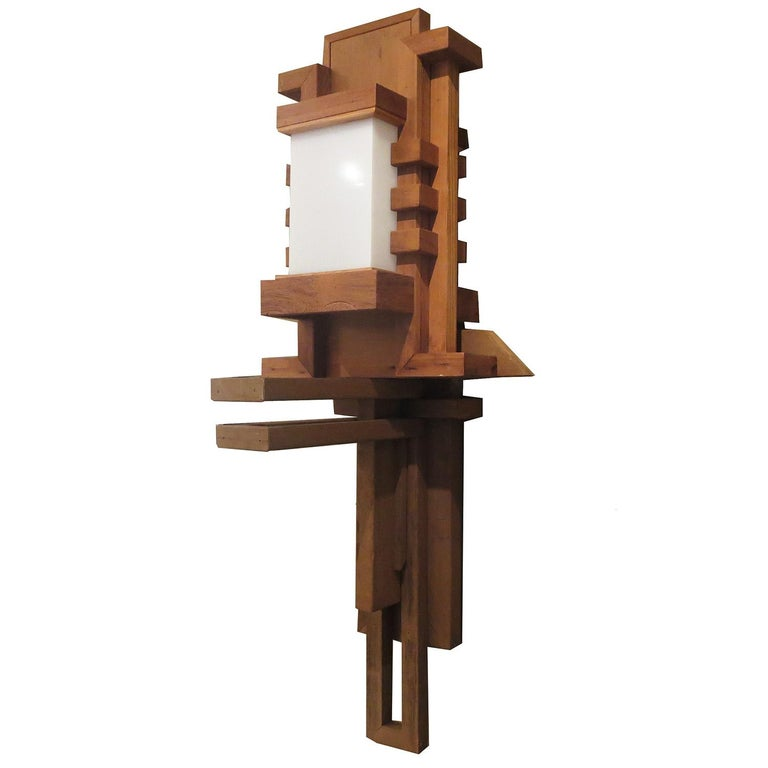 This incredible Frank Lloyd Wright inspired wall lamp was created for a 1950s La Crescenta, California modern home. The lamp and entire home, were an obvious homage to Americas premier architect / designer Frank Lloyd Wright. The fixture is