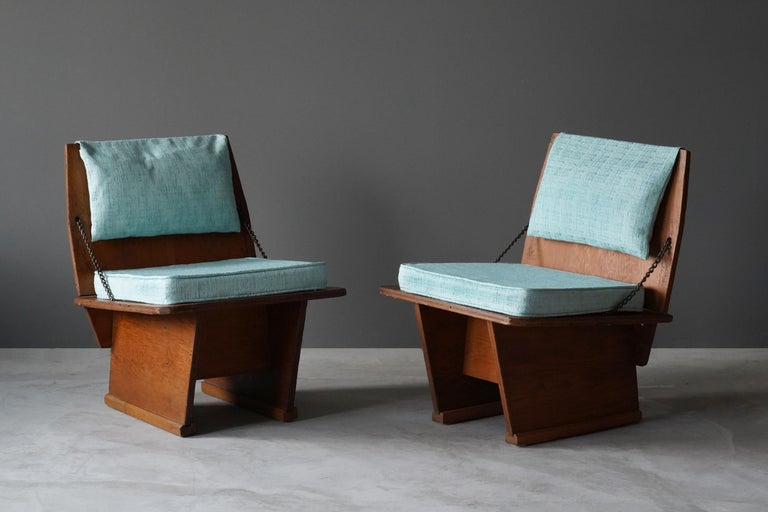 A rare pair of lounge chairs / slipper chairs designed by Frank Lloyd Wright produced by his Taliesin studio. Produced in limited numbers for Lloyd Wright's famous Unitarian Church in 1951. Marked. Purchase includes rare physical documentation.