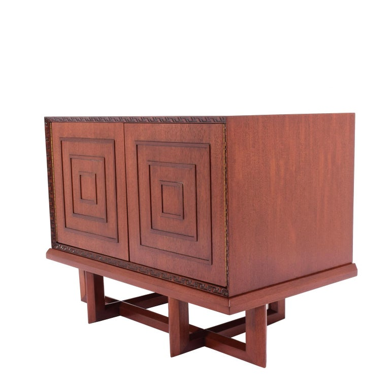 Two-door cabinet with one adjustable shelf design by Frank Lloyd Wright # 2005 in 1955 for Heritage Henredon, stamp in red inc on the back.