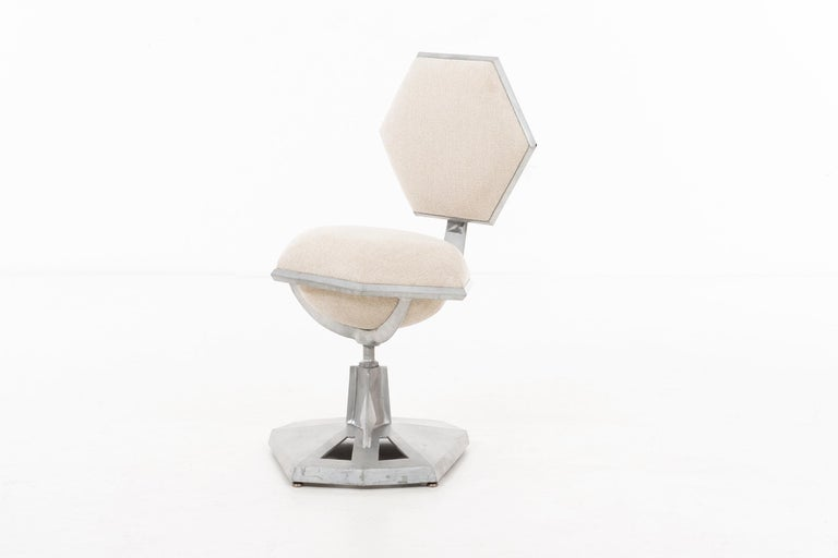 Wright cast aluminum chair for H.P. Price Tower Bartlesville, Oklahoma Faceted base with swivel seat and back. Literature: Prairie Skyscraper: Frank Lloyd Wright's Price Tower, Alofsin, pg. 148 illustrates variation.