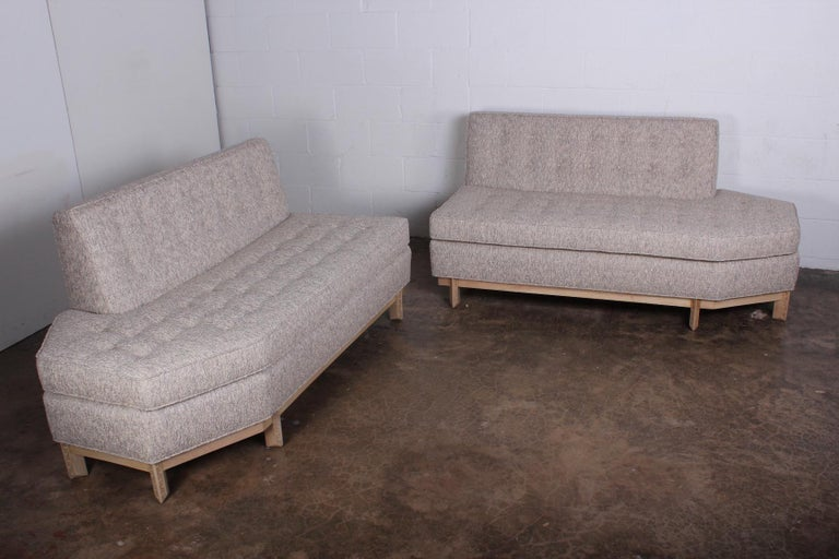 A beautifully restored two piece sofa designed by Frank Lloyd Wright for Henredon. Bleached mahogany frame with Robert Allen Lino boucle fabric.