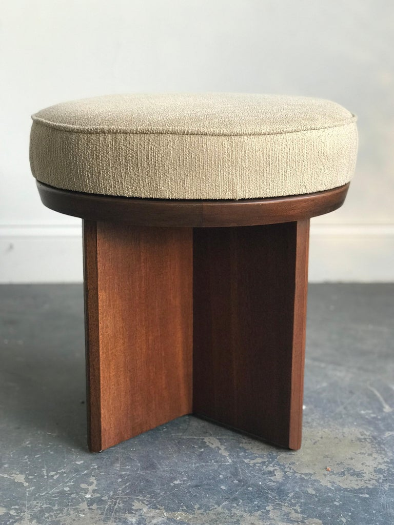 "A rare example from Frank Lloyd Wright's collaboration with Heritage Henredon; the swiveling stool. Mahogany base is in great original condition with a freshly upholstered seat.   Measures: 18"" across  18.6"" tall.  Lower cost delivery to NJ/ NY is"