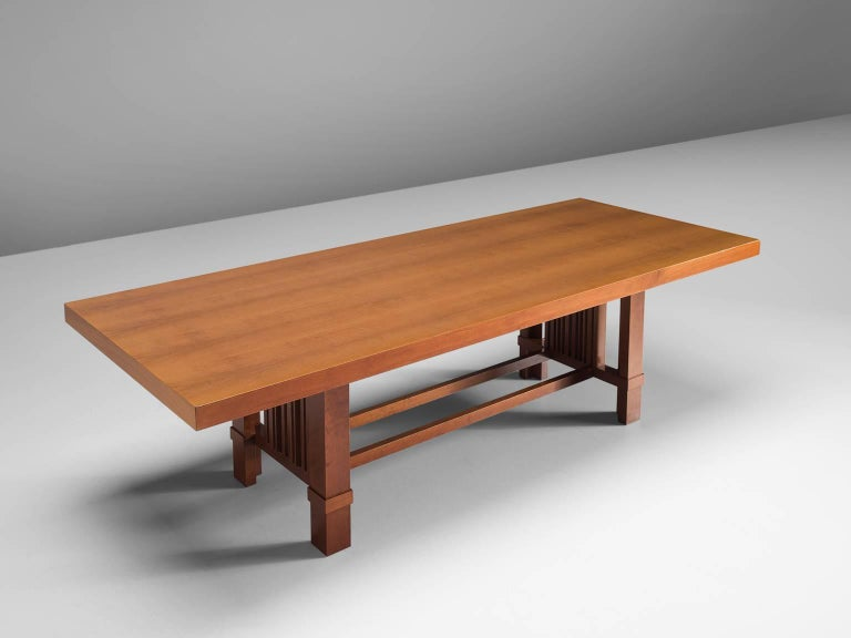 Frank Lloyd Wright for Cassina, 608 Taliesin table, cherry, design 1917, production 1989, United States,  This taliesin table is designed by Frank Lloyd Wright and produced by Cassina. The table has an incredibly architectural shape and form. The