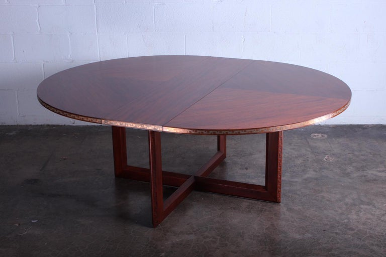 Frank Lloyd Wright for Heritage Henredon. Taliesin dining or game table. Mahogany table, concentric square pattern bookmatched with embossed copper