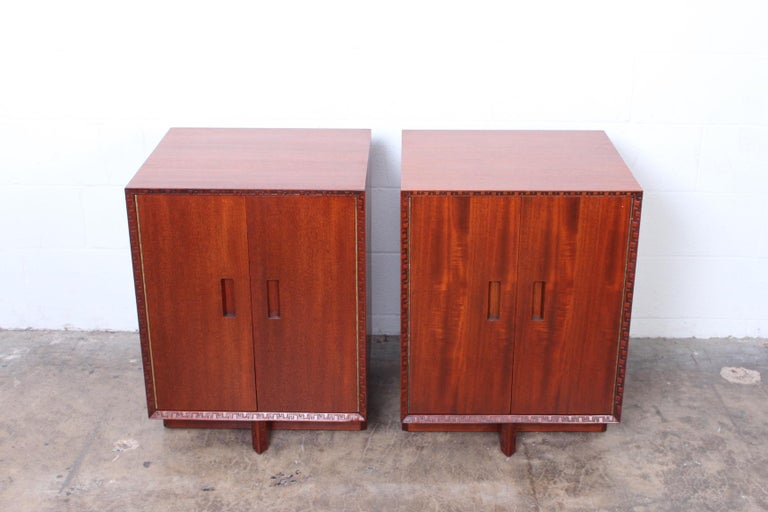 A pair of chests/nightstands by Frank Lloyd Wright for Henredon.