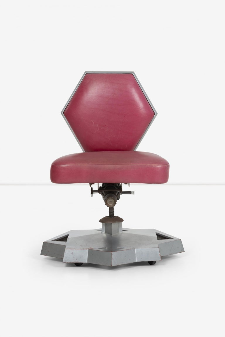 Frank Llyod Wright price tower chair, rare executive office chair from price tower, futuristic design is cohesive of the only high-rise building wright ever designed to fruition, bartlesville, oklahoma.  Red leather with tilt and swivel