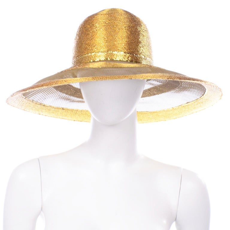 This is a such a fabulous vintage Frank Olive wide brim gold woven hat with a bow. This sensational vintage hat has alternating rows of woven gold straw and metallic sheer mesh or netting. This is such a statement piece and it comes from a woman who