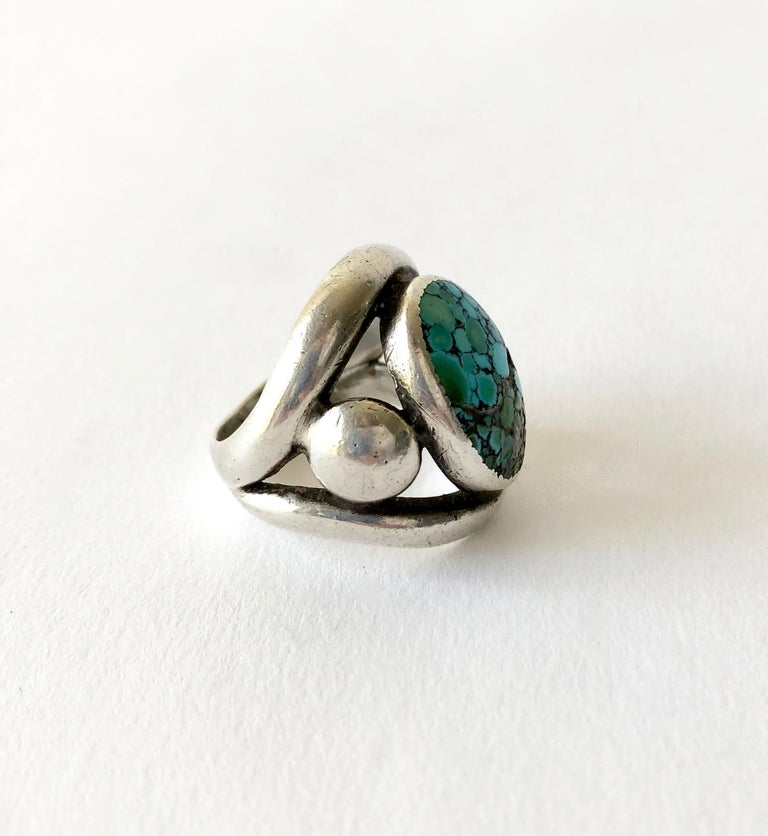 Modernist Navajo style sterling silver and natural #8 turquoise cabochon ring by Frank Patania Sr of Santa Fe, New Mexico.  Ring is a finger size 9 - 9.25 due to its open design.  Suitable for a man or woman and in very good vintage