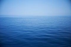 Seascape X - large format photograph of monochrome blue water surface & horizon