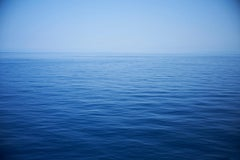Seascape X - large format photograph of monochrome blu water surface and horizon