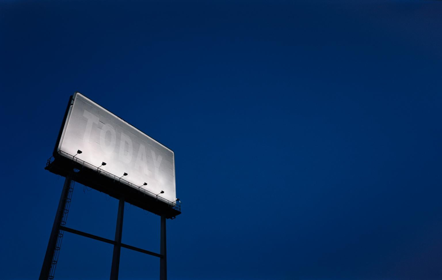 TODAY - large format photograph of conceptual motivational billboard at night