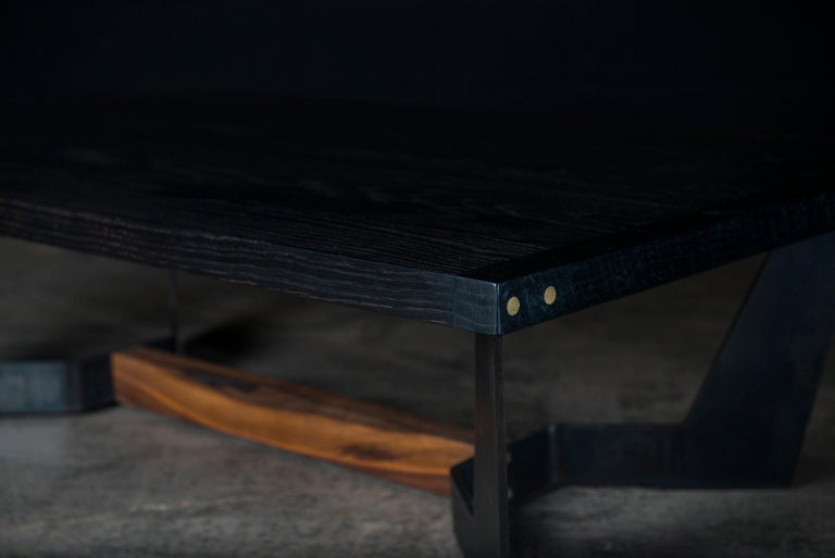 The Frankin center table is handmade from a thick solid wood surface & featured subtitle hand polished brass details at the end. It has a hand rubbed natural oil and wax finish that enhance the real beauty of the wood and give a natural warm touch.